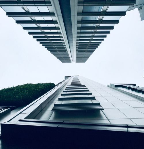 Architecture Hong Kong Streetphotography HongKong ShotOnIphone Architecture Sky Built Structure Day Diminishing Perspective Building Exterior No People Directly Below Outdoors Building Plant Clear Sky Nature City Direction Bridge