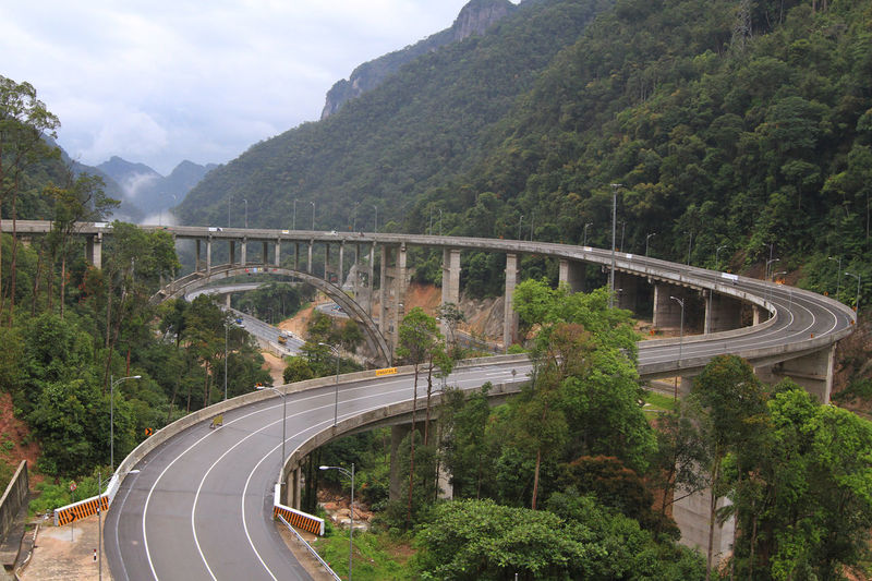 Curved Nine is winding road which is located about 30 km east of Payakumbuh, West Sumatra, heading Riau Province. Architecture Bridge - Man Made Structure City Day Infrastructure Mountain Nature No People Outdoors Road Transportation Travel Tree
