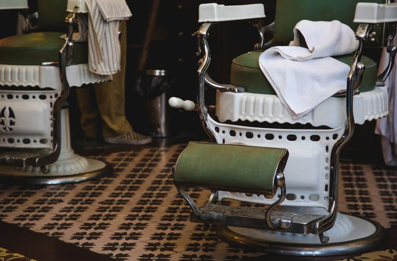 Close-up of towel on barber chair at salon