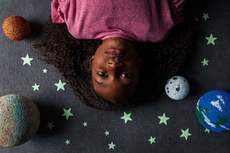 Portrait of girl lying on floor