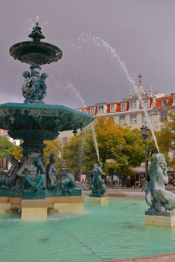 Lissabon, Portugal Lisboa Portugal Lisbon - Portugal Streets Of Lisbon EyeEm City Shots EyeEm City Lover Architecture Water Fountain Built Structure Building Exterior Sculpture Travel Destinations Splashing Art And Craft Sky Tree Outdoors Long Exposure Day Flowing Water