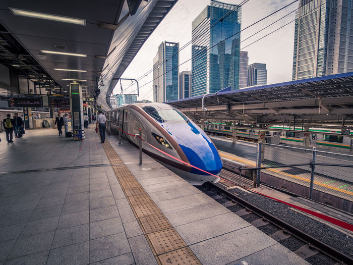 Tokyo Station trainspotting Japan Japan Photography Shinkansen Tokyo Architecture Building Exterior Built Structure City Day Land Vehicle Mode Of Transport Motion Outdoors Public Transportation Rail Transportation Railroad Station Railroad Station Platform Railroad Track Real People Train - Vehicle Transportation