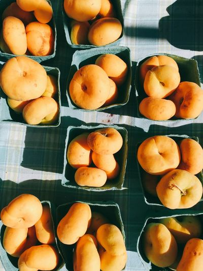 Directly Above Shot Of Peaches In Box On Table For Sale In Market