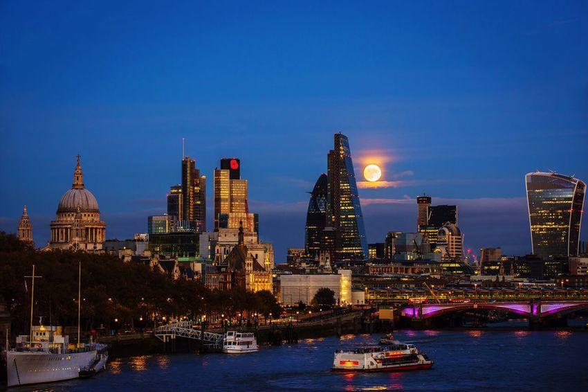 London Super Moon 2016 LONDON❤ City Illuminated Skyscraper Outdoors Night Heron Tower The Cheesegrater Building Blackfriars Bridge River Thames Tower 42 WalkieTalkie Moonrise The Gherkin Building St. Paul's Cathedral Skyline Cityscape Nightphotography EyeEm Best Shots Spectacular Scenery