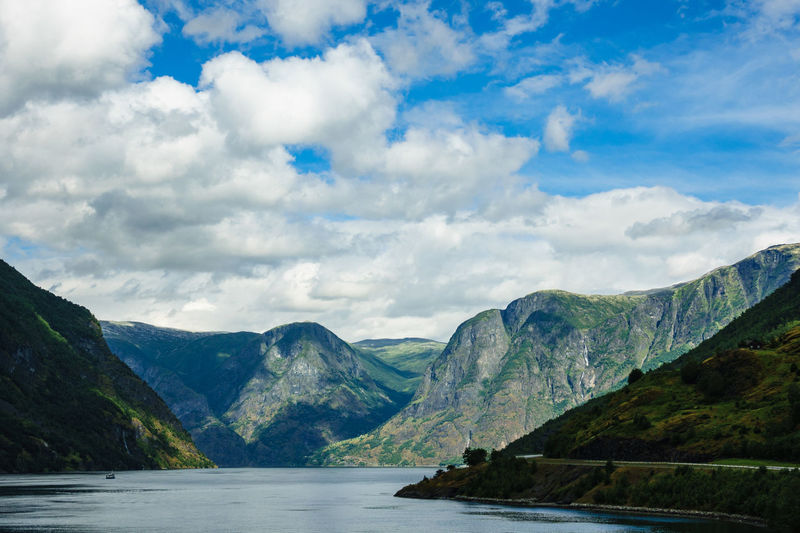 View to the Aurlandsfjord in Norway. Norway Relaxing Sky And Clouds Aurlandsfjord Beauty In Nature Clouds And Sky Day Fjord Flåm Journey Landscape Mountain Mountain Range Mountains Nature No People Outdoors Scenery Scenics Tourism Tranquil Scene Travel Destinations Vacation Water