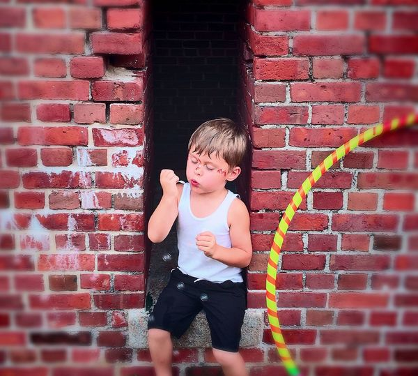 My little sweetheart blowing bubbles. Childhood Toddler  Brick Wall Wall - Building Feature Cute Innocence Brick Person Red Child Day Outdoors Bubbles Blowing Bubbles Key West Key West Summer Martello Capturing Innocence Fresh On Eyeem