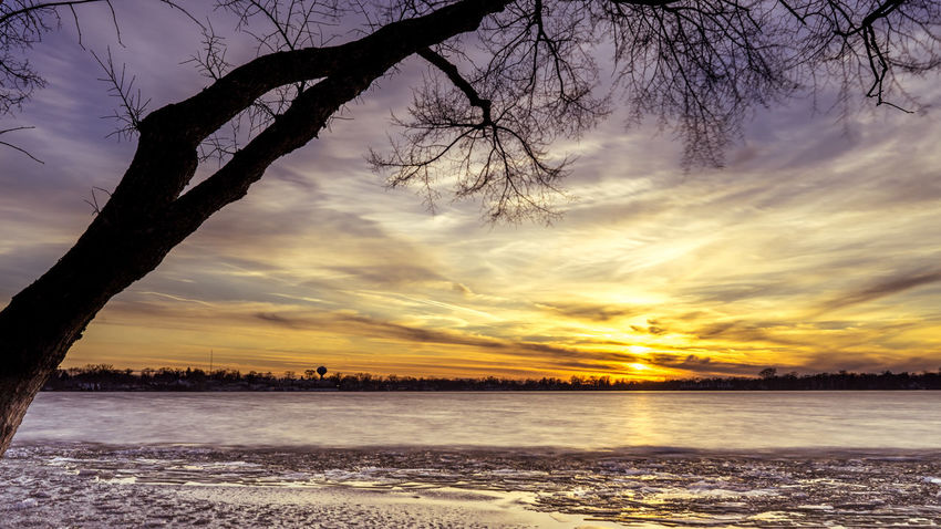 Beauty In Nature Cloud - Sky Dramatic Sky Dusk Evening Landscape Long Exposure Nature No People Outdoors Sea Sky Sunset Tree Water