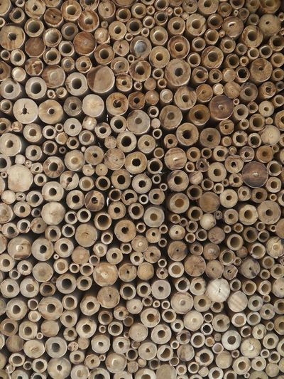 Full frame shot of stack of wood