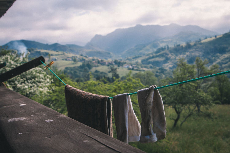 Clothesline hanging in balcony against mountains