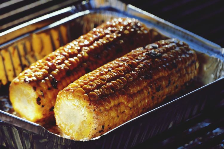 Close-up of corn on the cob in plate