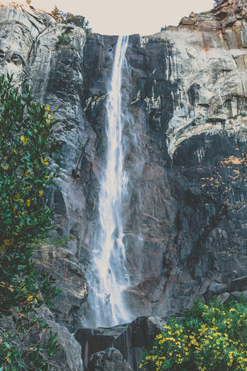 Scenic mountain region comprising the Sierra Nevada Range & Yosemite Valley of the Merced river; famous for giant sequoias, huge rock domes & peaks. Yosemite National Park Beauty In Nature Day Nature No People Outdoors Scenics Sky Travel Destinations Tree Water Waterfall