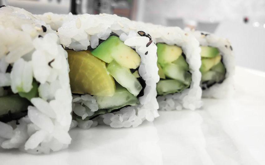 Japanese cuisine. Closeup of fresh veggie maki rolls with avocado. Asian  Avocado Backgrounds Closeup Cuisine Diet Dinner Eat Food Gourmet Health Japan Japanese  Maki Meal Oriental Raw Rice Roll Seafood Sushi Uromaki Vegan Vegetarian Veggies