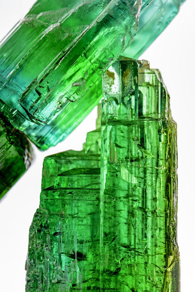Detail of brazilian green tourmaline crystal with its texture, colors and transparency Crude Gemmy Natural Nature Quartz Rock Close-up Crystal Expensive Gem Gemology Gemstone  Geological Glassy Green Color Jewelery Matrix Mineral Mineralogy Precious Gem Stone Transparent Turmalin Turmaline Uncut
