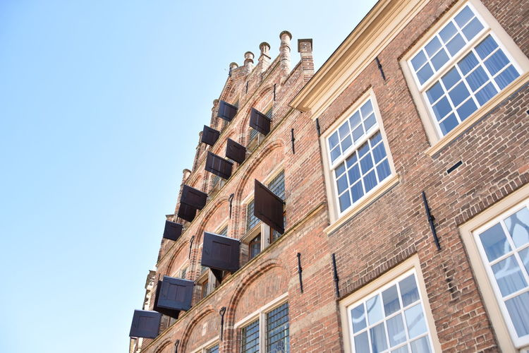 Amsterdam Apartment Architecture Blue Building Building Exterior Built Structure City Clear Sky Copy Space Day Dutch Glass - Material House Low Angle View Nature No People Old Buildings Outdoors Residential District Sky Sunlight Wall Window