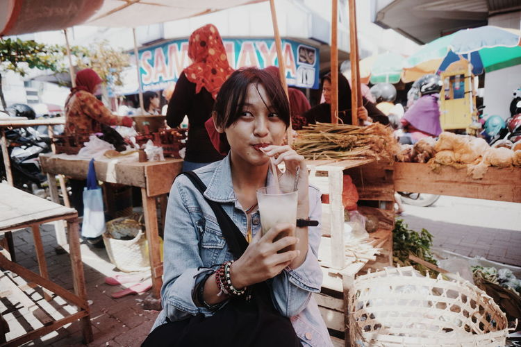 Young woman standing at market stall