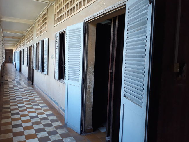 Tuol Sleng Genocide Museum. Tuol Sleng Genocide Museum Phnompenh Genocide Museum Perspective EyeEmNewHere EyeEm Selects Door Architecture Corridor Indoors  No People Built Structure Day