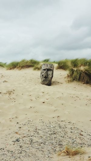 On a beach in Wales Sculpture Beach Windy Day Wales Cloud - Sky Sand Dune EyeEmNewHere
