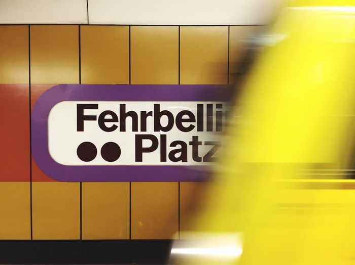 Blurred motion of yellow train at arriving at subway station