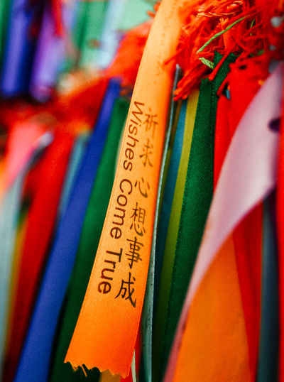 Yellow ribbon with wishes in Chinese letters Chinese Letters Macro Photography Ribbon Wishes Wishes Come True Close-up Macro Ribbon With Wishes Temple Temple Wishes Wish Wish Collection Wishes For Everyone Wishes In The Wind Yellow Ribbon