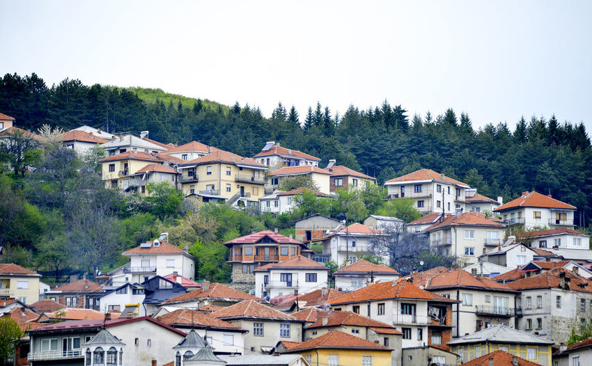 Houses in city against clear sky