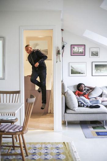 Men in sofa at home