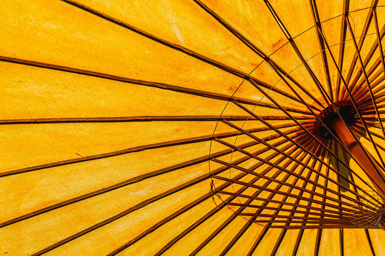 A pattern from an umbrella. no people day yellow Low angle view outdoors pattern full frame backgrounds umbrella protection parasol Security close-up safety sunshade metal Shade shelter beach umbrella spoke minimal Minimalist Architecture Business No People Day Yellow Low Angle View Outdoors Pattern Full Frame Backgrounds Umbrella Protection Parasol Security Close-up Safety Sunshade Metal Shade Shelter Beach Umbrella Spoke Minimal