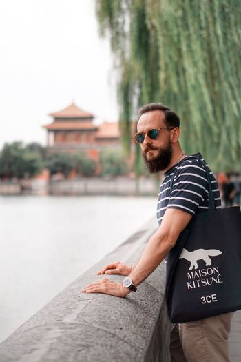 One Person Beard Glasses Casual Clothing Architecture Focus On Foreground Lifestyles Adult Real People Leisure Activity Water Sunglasses Men Young Men Facial Hair Fashion Young Adult Day Standing Outdoors