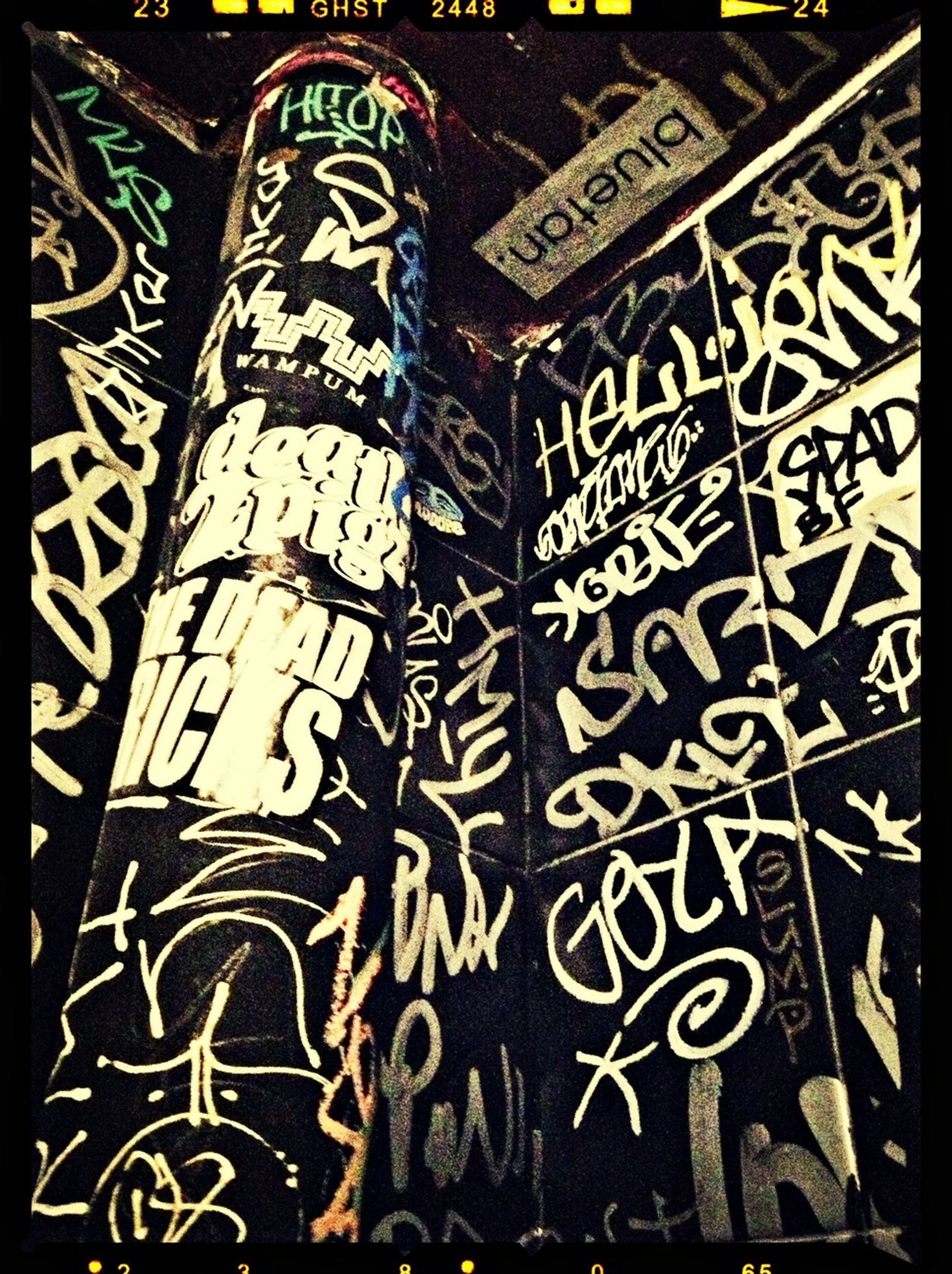 graffiti, art, creativity, indoors, art and craft, transfer print, pattern, design, wall - building feature, auto post production filter, built structure, architecture, text, human representation, wall, street art, western script, communication, one person, day