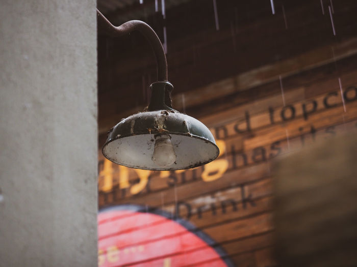 Close-up of pendant light hanging on wall
