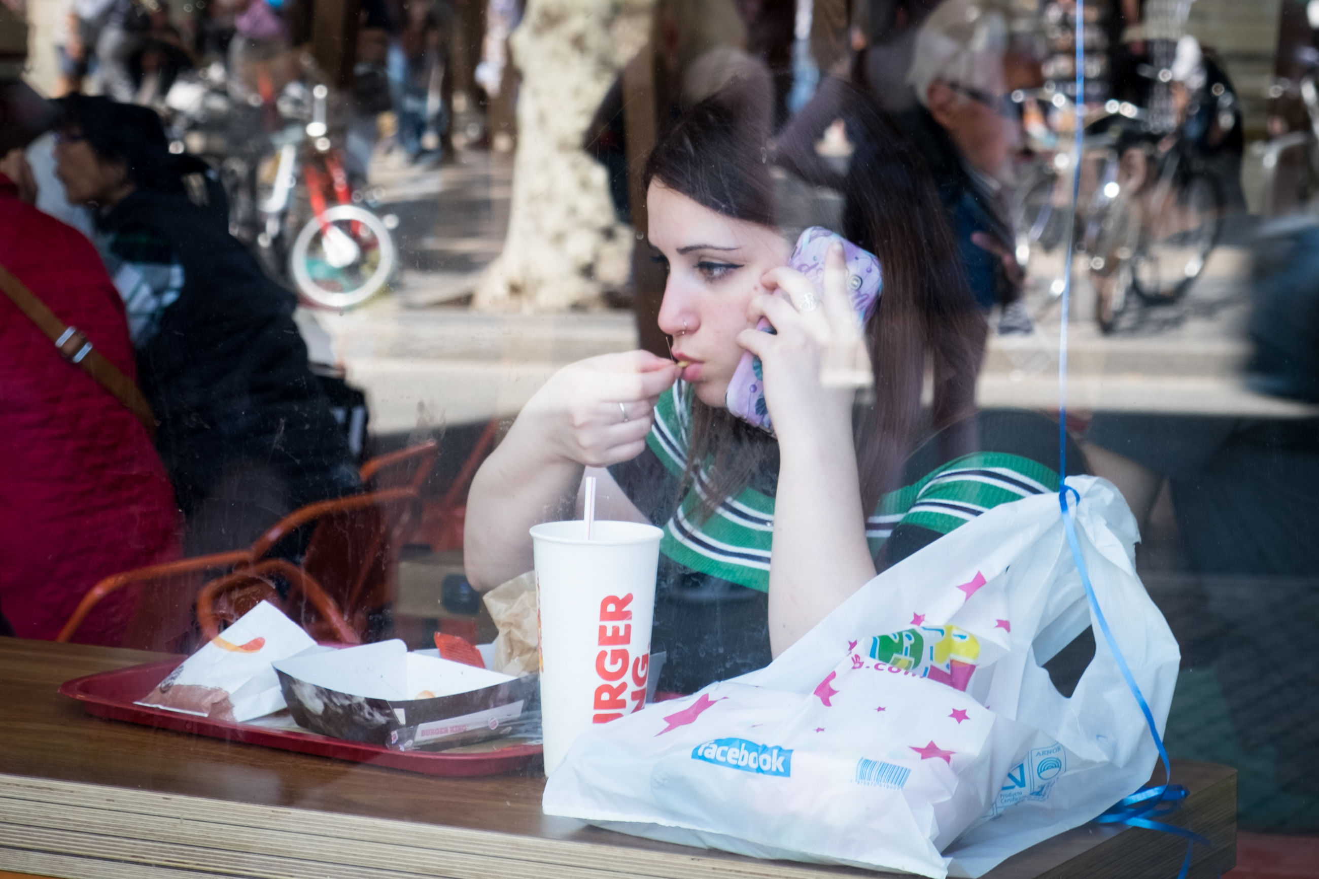 table, young adult, incidental people, sitting, one person, food and drink, real people, women, drink, young women, waist up, business, holding, looking, leisure activity, lifestyles, adult, portrait, drinking, outdoors