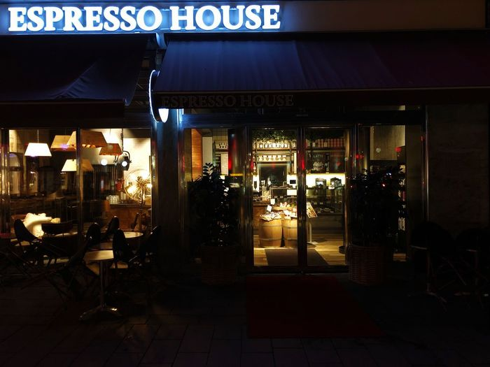 Espresso house Espresso House Night Illuminated Architecture Built Structure Business Text Communication Restaurant Building Exterior Lighting Equipment Table Seat Western Script Food And Drink Chair Entrance Bar - Drink Establishment Store No People Bar Counter