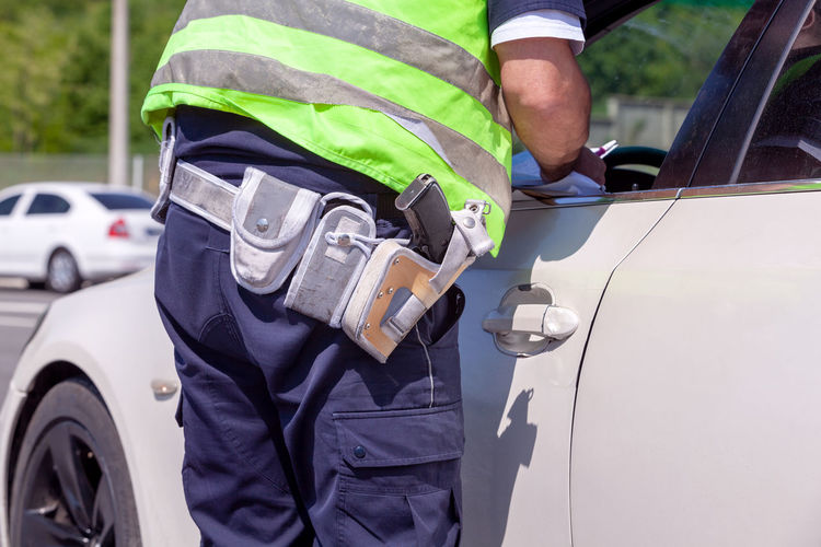Midsection of man working on car