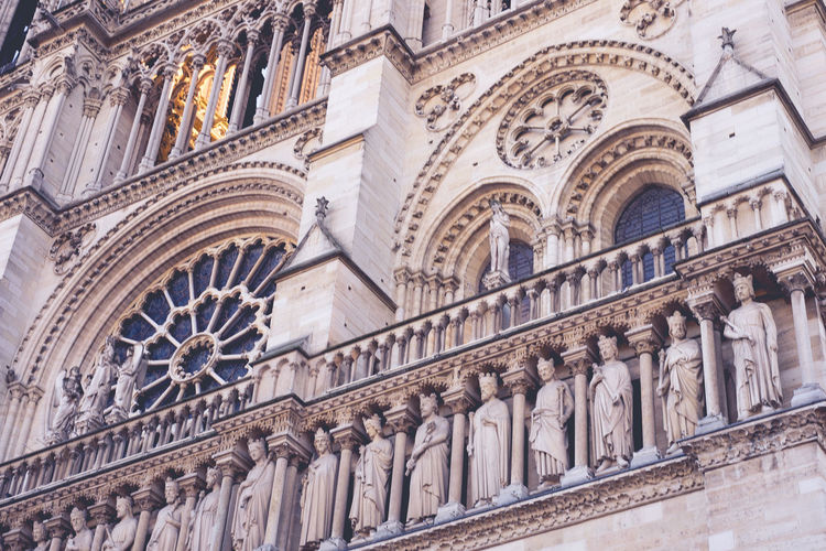 Architectures of Paris, France. Architecture Low Angle View Built Structure The Past History Building Exterior Building Travel Destinations Place Of Worship No People Religion Belief Spirituality Day Window Travel Architectural Column Outdoors Ornate Gothic Style Architecture And Art Notre Dame De Paris