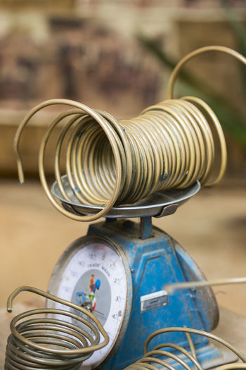 Close-up coiled metal on weight scale