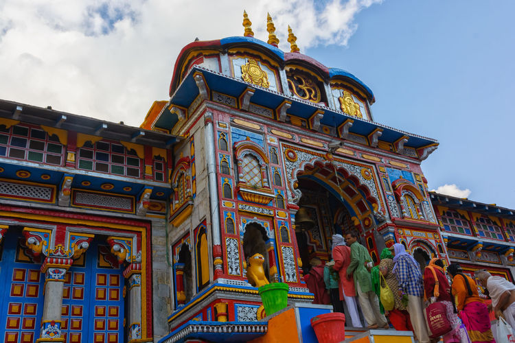 Badrinath Temple Badrinath Architecture Art And Craft Badrinath Temple Belief Building Building Exterior Built Structure Cloud - Sky Creativity Day Group Of People History Low Angle View Nature Ornate Outdoors Place Of Worship Religion Representation Sky Spirituality The Past