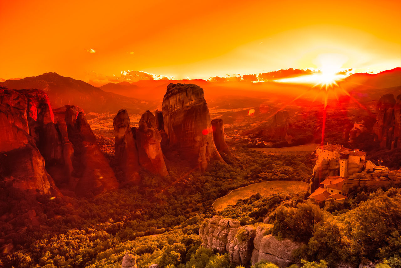 Spectacular colorful sunset over the valley of Meteora, from the best view point, a rock called Psaropetra, Kalambaka, Meteora, Central Greece. Monastery Beauty In Nature Day Greece Landscape Meteore Nature No People Orange Color Outdoors Rock - Object Scenics Sky Sun Sunlight Sunset Tranquility Travel Destinations