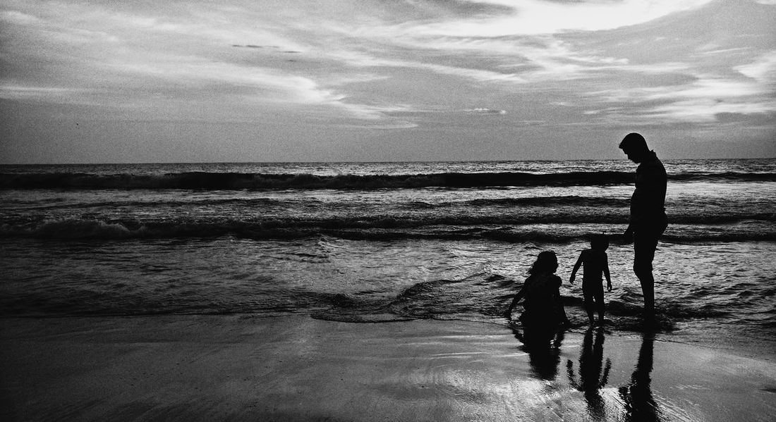 Beach in Kozhikode. A Weekend with children. Clicked Unknowingly and without Permission. G2photographs EyeEm Best Shots EyeEmNewHere EyeEm Nature Lover Eyemphotography Beach Family Evening Weekend Child Enjoying Life Candid Blackandwhite Parents Lifestyles Sea Real People Outdoors Horizon Over Water First Eyeem Photo EyeEmNewHere People Nature Full Length