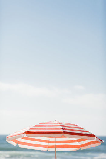 Umbrella against sky at beach