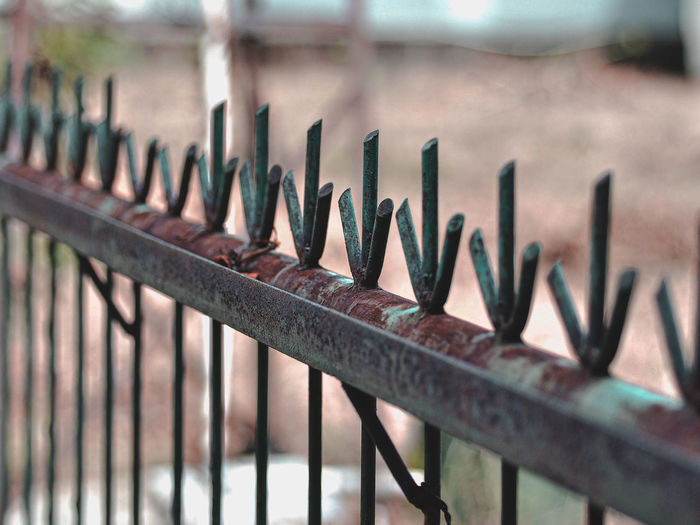 Close-up of a rusty old fence