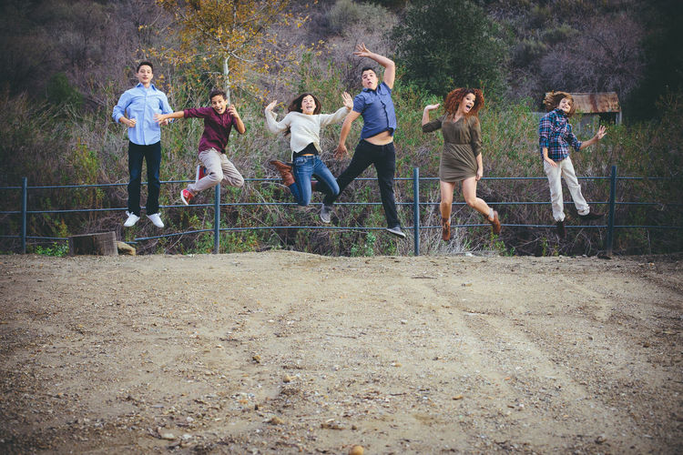 Group Of People Full Length Casual Clothing Women Group Tree Child Standing Medium Group Of People Togetherness Leisure Activity Fun People Males  Adult Girls Real People Day Teenager Outdoors Adolescence  Teens Jumping Happiness Smiles