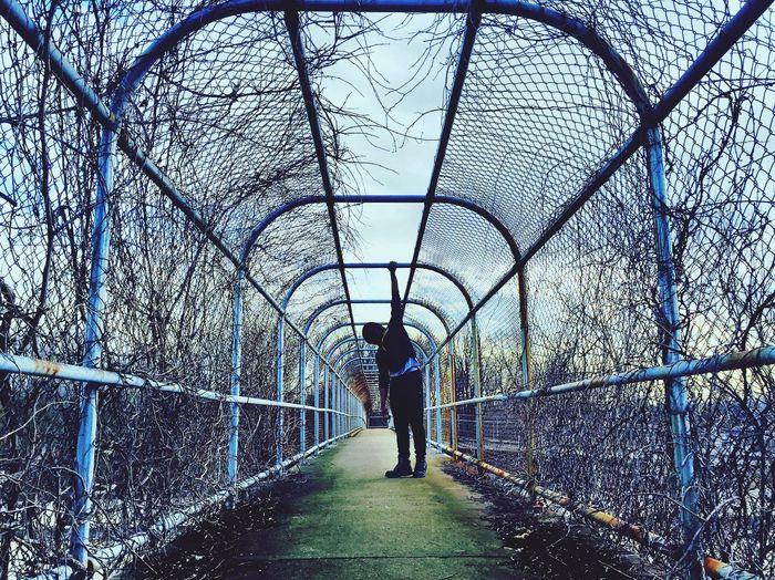 Full Length Of Man On Bridge Against Sky
