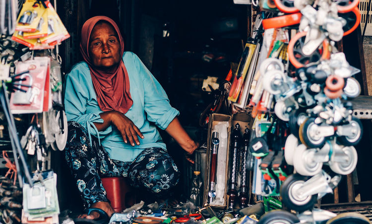 how about you buy my goods? Streetphotography Street Photography Streetphoto_color Streetvendor Old Old Woman Old Person Stall Oldmanportrait Traditional Market Marketplace The Street Photographer - 2018 EyeEm Awards Portrait City Musician Repair Shop Men Arts Culture And Entertainment Looking At Camera