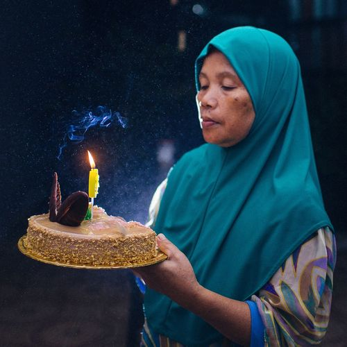 Birthday celebration EyeEm Selects EyeEm Best Shots EyeEmNewHere Islam Muslim Cake Birthday Happy Birthday! EyeEm Selects One Person Men Adult Nature Clothing Food And Drink Food Emotion Night Lifestyles Blue Real People Portrait HUAWEI Photo Award: After Dark