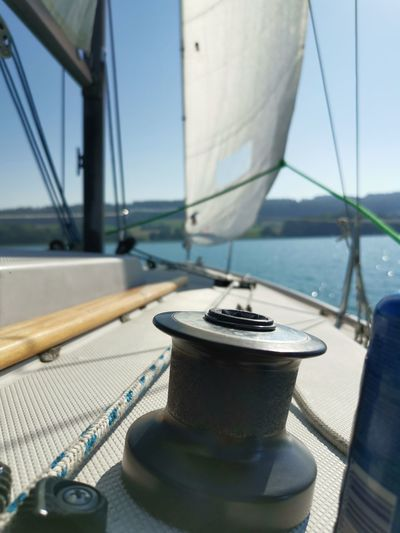 Close-up of sailboat in sea against sky