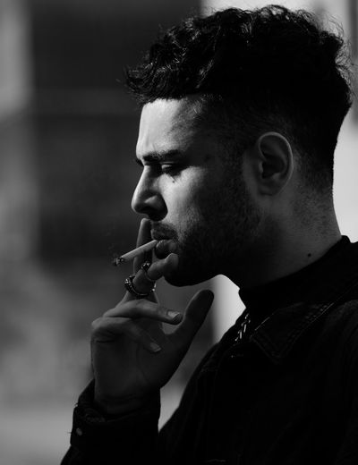 🚬 Picoftheday Portrait Photography eyeemphoto Eye4photography  Travcimages Photooftheday Modeling EyeEm Gallery Nycphotographer Blackandwhite Photography Bnw_collection Black And White Portrait One Person Real People Headshot Cigarette  Lifestyles Portrait Smoking - Activity Young Men