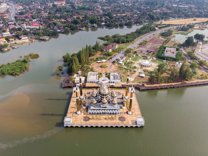 High angle view of crystal mosque by river