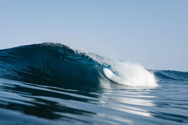 Blue wave breaking on the beach in tenerife