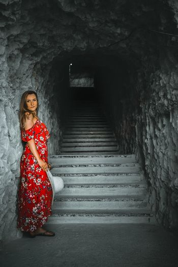 Stairs in the rock and red dressed woman Portrait Full Length Beauty Young Women Beautiful People Red Females Looking At Camera Standing Fashion Model Spiral Staircase Sequin Staircase Jack O Lantern Cocktail Dress Traditional Dancing Steps And Staircases Hand Rail Stairway Steps Spiral Stairs Stairs Witch Monsoon Escalator Sleeveless Dress Wearing Artist's Model Fashion Show Posing