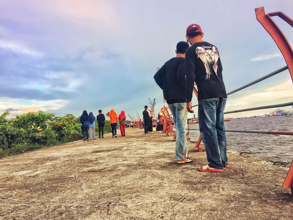 Check the Photo IPhoneography Streetphotography Rear View Sky Full Length Real People Standing Men Casual Clothing Day Cloud - Sky Medium Group Of People Togetherness Outdoors Women Friendship Nature Adult People