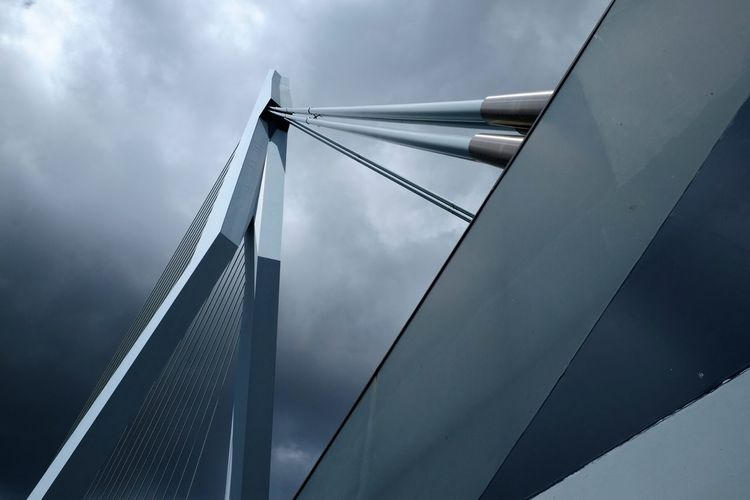 Low Angle View Of Erasmusbrug Bridge Against Cloudy Sky At Dusk